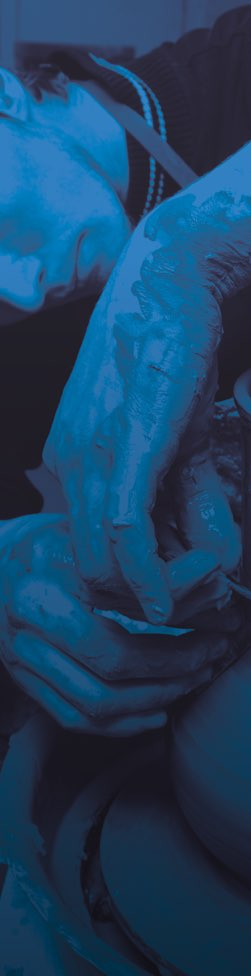 Blue tinted image of man doing pottery
