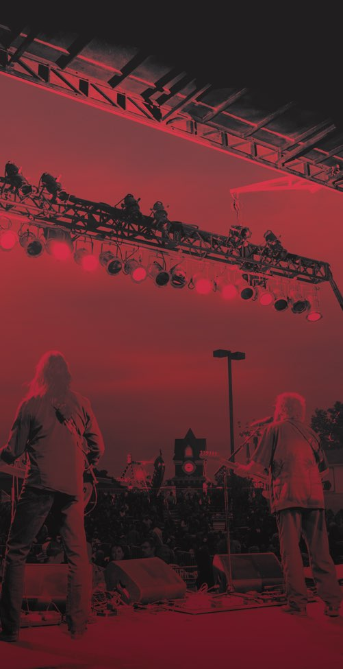 Red tinted image of main stage